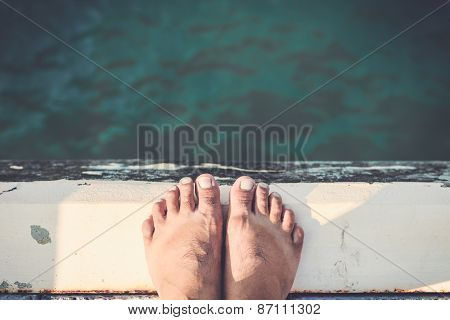Bare Feet Standing On Cement Edge