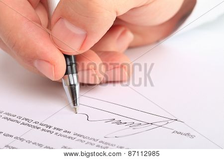 Detail Of A Male Hand Signing A Contract