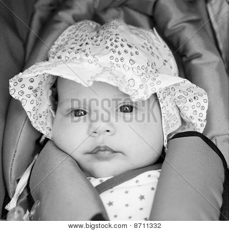 Little Girl In Baby-seat