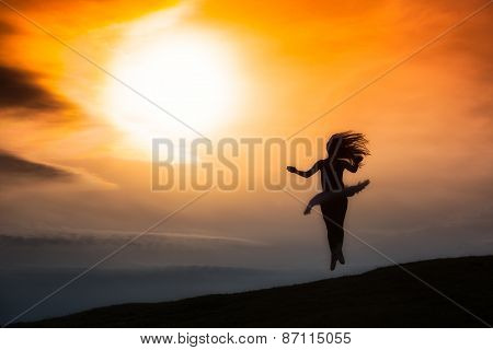 Ballerina Silhouette, Dancing Alone In Nature In The Mountains At Sunset