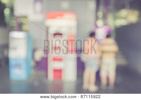 Blurred Background : People Stand Infront Of Atm Machine