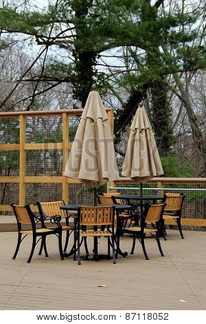 Tables and chairs with umbrella on patio