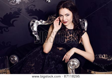 Gorgeous Woman In Elegant Black  Dress Posing In Luxurious Interior