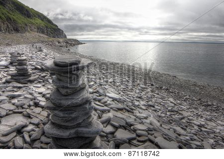 Stack Of Stones On Fjord Background