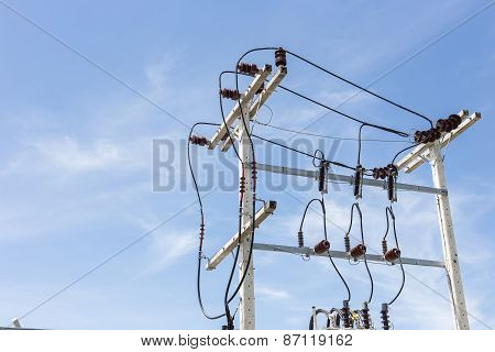 Electric Pole And Cable With Blue Sky
