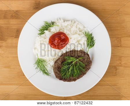 Fried Meatballs In A Glass Platel With Dill And Tomato Ketchup