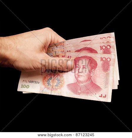 Chinese 100 Yuan Renminbi Banknotes In Hand