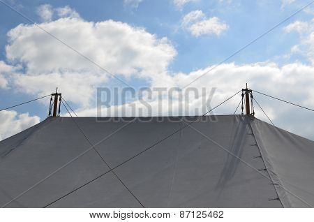 Marquee roof under a blue sky.