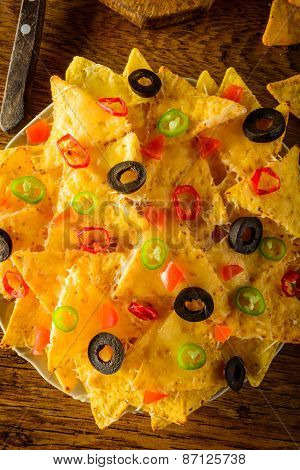 Nachos With Cheese, Olives And Chili