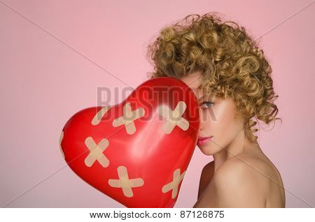 Distressed Woman With Ball In Shape Of Heart