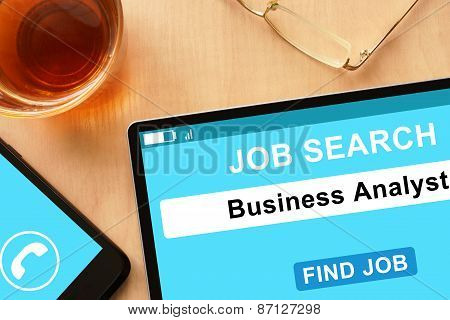 Tablet with Business Analyst on  job search site.