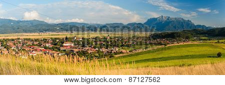 Vulcan Village And Bucegi Mountain In Transylvania