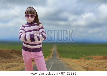 Teenage Girl In Pink With Road In Background