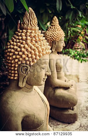 Sitting stone Buddha statues at temple area