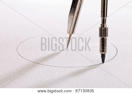 pair of compasses drawing circle