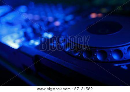 DJ mixer with light colored spotlights discos
