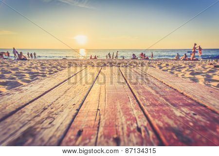 Top Of Wooden Table At Sunset Beach In Thailand