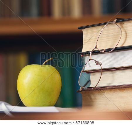 glasses on the books