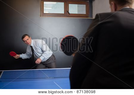 Businessman play tennis