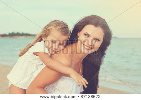 Mother And Her Little Daughter Hugging.