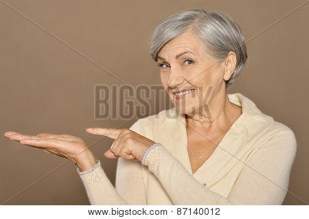 Senior woman pointing