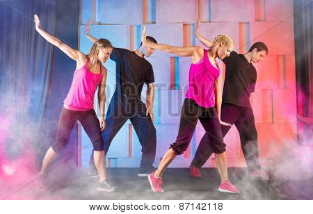 Group young people practicing fitness dance