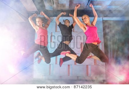 Group of young people jumping during music