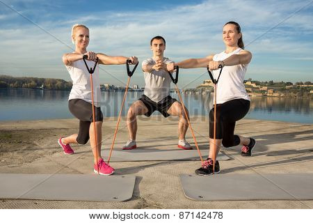 Active people exercising with a resistance band outdoor