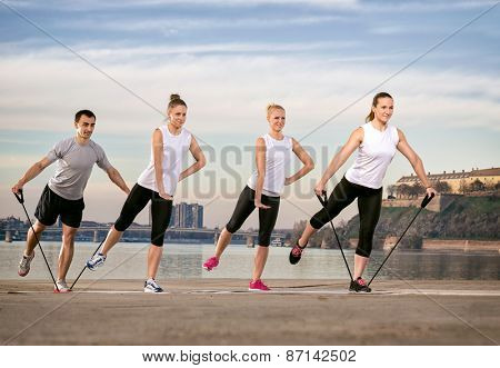 group exercise with resistance rubber, outdoor