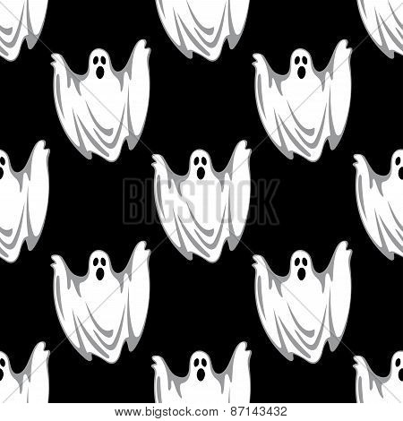 Cartoon scary ghosts in Halloween seamless pattern