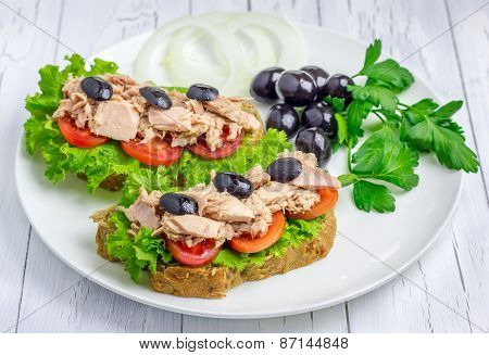 Healthy Sandwiches With Tuna Fish On The White Plate
