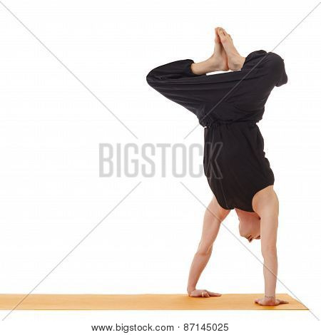Yoga lessons. Image of instructor doing handstand