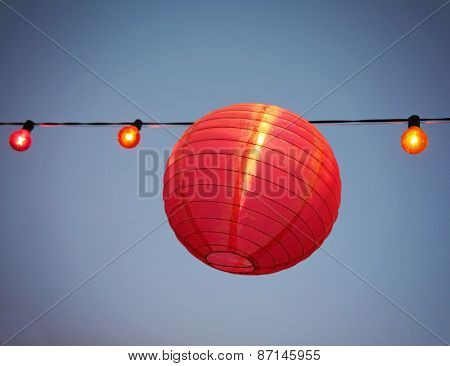 Chinese Paper Lanterns at a party during the evening