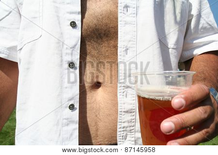 a man holding a beer in a cup with a bare belly