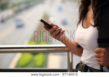 young woman use cellphone in city