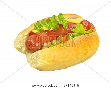 Delicious Hot Dog With Mustard, Ketchup And Lettuce Isolated On White