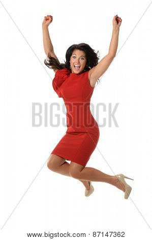 Businesswoman celebrating by jumping isolated over white background