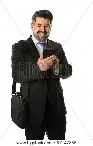 Portrait of mature Hispanic businessman using cellphone isolated over white background - Focus on phone