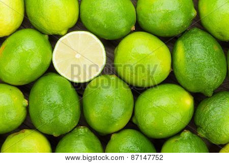 Fresh ripe limes on wooden table