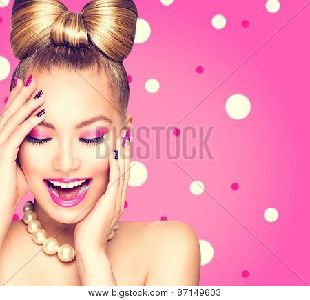 Beauty fashion happy model girl with funny bow hairstyle, pink nail art and makeup over polka dots b