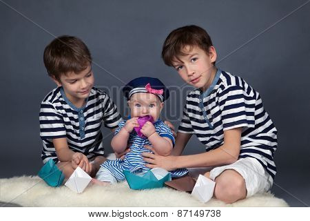 Portrait Of Happy Brothers And Cute Small Sister