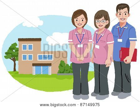 Smiling Caregivers With Nursing House Background