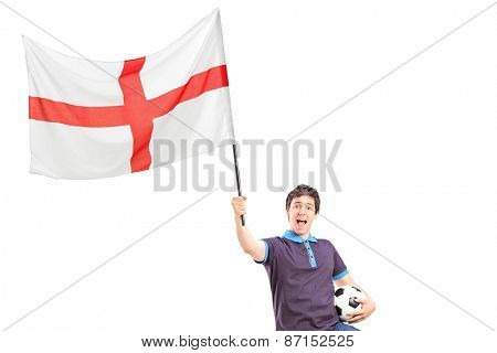 Euphoric young football fan holding an English flag and football isolated on white background