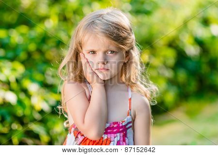 Sad Little Girl With Long Blond Hair Suffering From Toothache