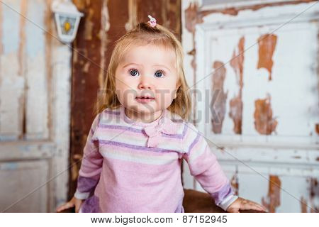 Amazed Funny Blond Little Girl With Big Grey Eyes And Plump Cheeks Looks Up