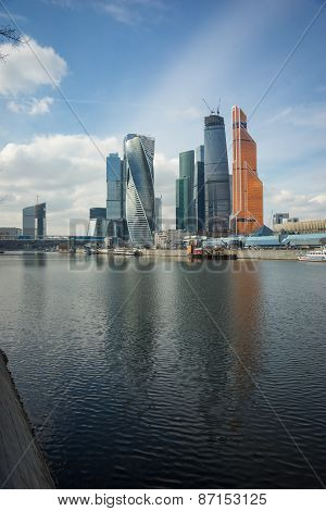 Picturesque View Of The Moscow City Across The River Moscow With Reflection In Water,
