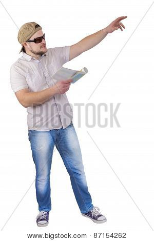 Man with guide book in a hand on white background