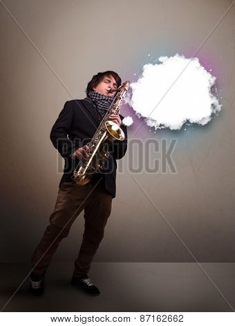 Handsome young man playing on saxophone with copy space in white cloud