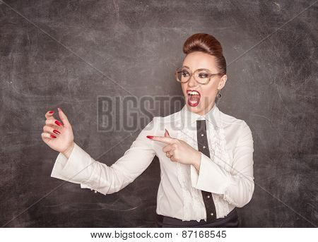 Beautiful Fashion Woman Pointing On Something In Her Hand