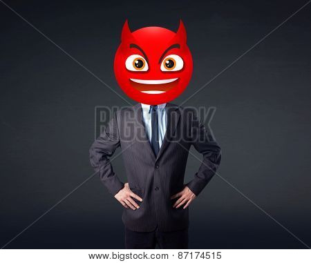 Funny businessman wears devil smiley face